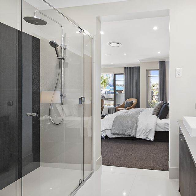 Resort style ensuite open and spacious in this master for Modern ensuite ideas
