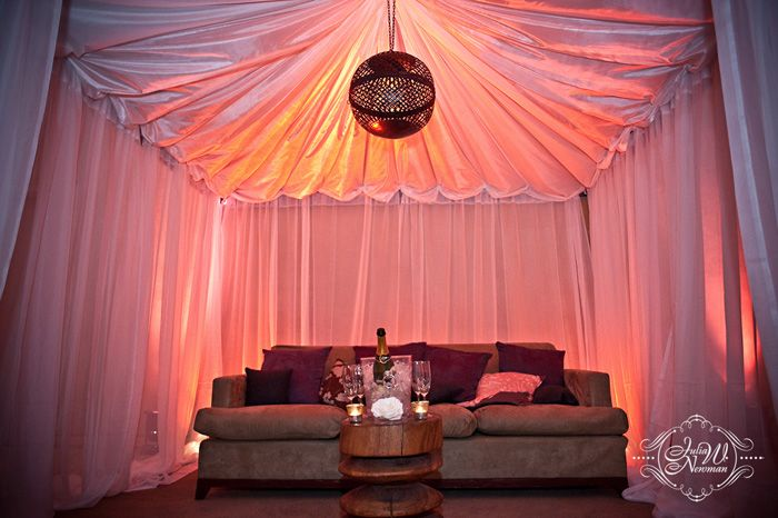 Love the #coraluplighting with the touch of #orangeuplighting to create a chic lounge feel complete with vintage champagne/wine bucket. I don't think I'd leave the couch for the entire event ;)
