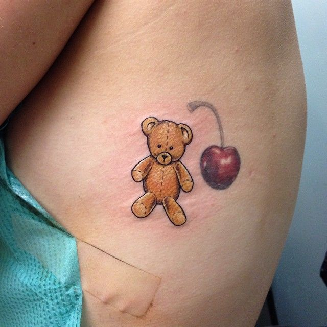 The perfect Teddy bear to go with Baby doll...Maybe have her hold it with one hand as it hangs down
