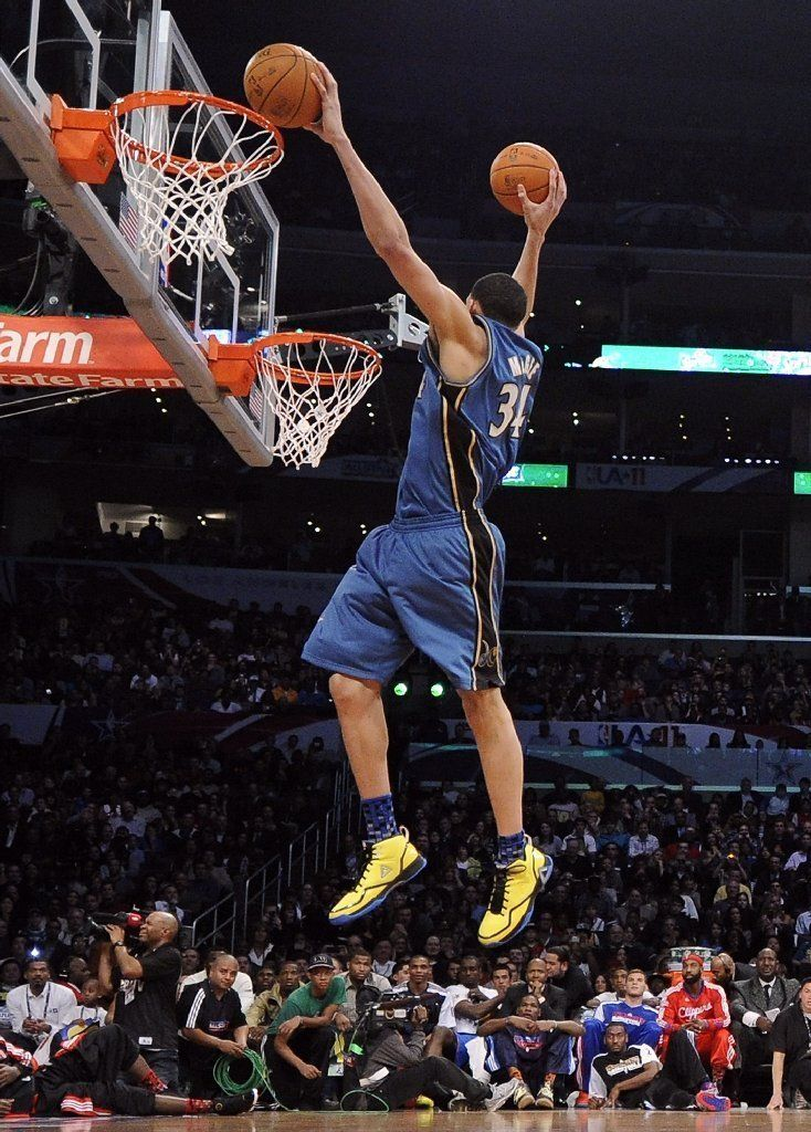 amazing long arms holding the two basketball. this basketball player Javale McGee is too good. and this batch of dunks is the most amazing basketball contest for me.   http://media.mlive.com/sportsnow_impact/photo/nba-all-star-basketball-41jpg-547721402b658d33.jpg
