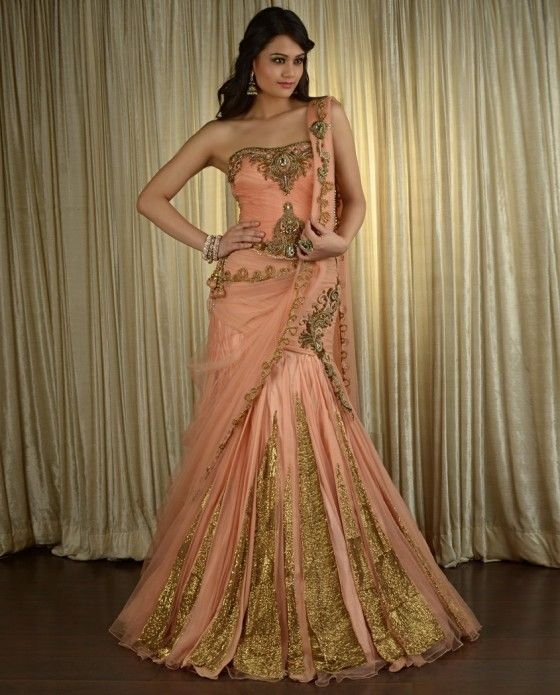 Offbeat Elegant Ruffled Peach Lengha Price $4,875.00, available at Exclusively. It could be worn as a wedding gown, reception gown, or perhaps as a brides maids dress