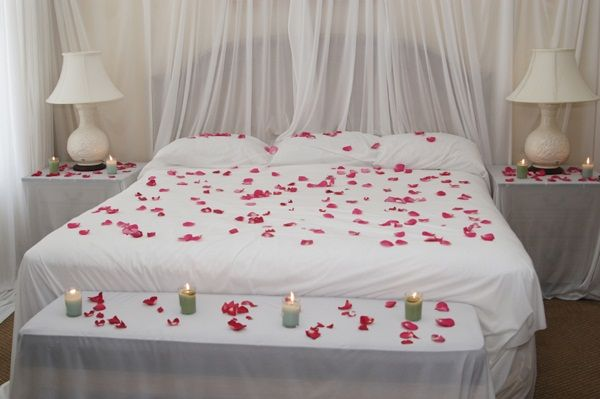 Romantic Beds candles and flowers on bed - 10 romantic bedroom decorating ideas