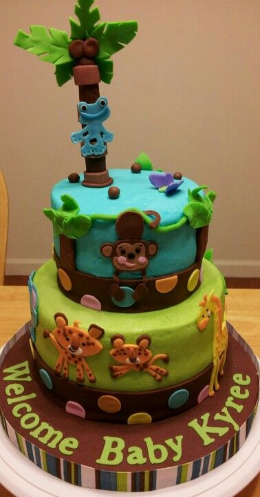 Jungle safari animals baby shower cake my creations for Baby footprints cake decoration