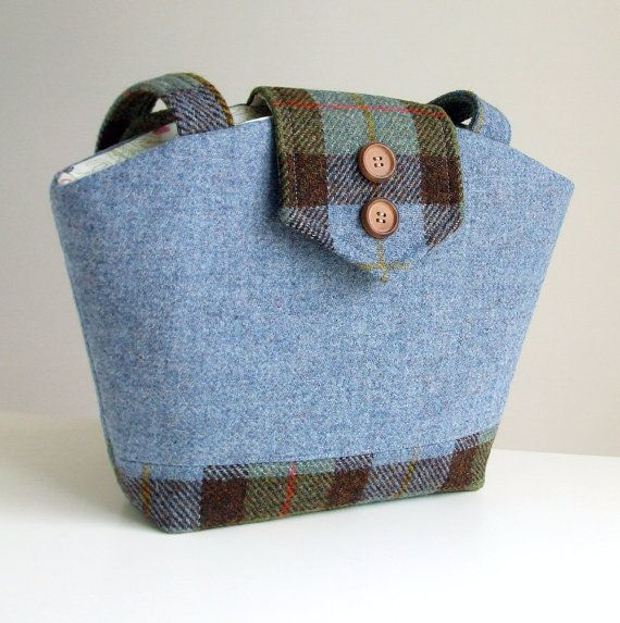 Harris Tweed Purse Two Tone - One of a Kind Bag.    This purse is made from exclusive Harris Tweed wool in a blue weave and a Macleod check which were imported from a lovely shop located on the Isle of Harris, Scotland. Harris Tweed is a luxury cloth handwoven by the islanders in their homes on the Outer Hebrides of Scotland, using local wool. The Harris Tweed label is sewn onto the back of the bag. The flap has a magnetic closure and is adorned with two wood buttons. The purse is fully…