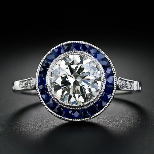 My engagement/wedding ring is a platinum Art Deco with mine cut diamonds from the 1930s.  These rings aren't for everyone, but I absolutely love them!  I love the geometric details and framing and the old cuts (just look at the ring of sapphires).  I usually prefer no color but this ring is gorgeous.
