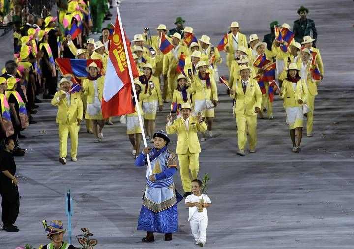 Temuulen Battulga carries the flag of Mongolia during the opening ceremony for the 2016 Summer Olympics in Rio de Janeiro, Brazil, Friday,…
