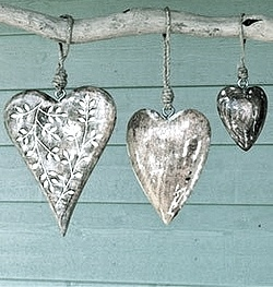(Original as re-pinned) Silver hanging heart ornaments - lovely to hang in the trees in the garden.