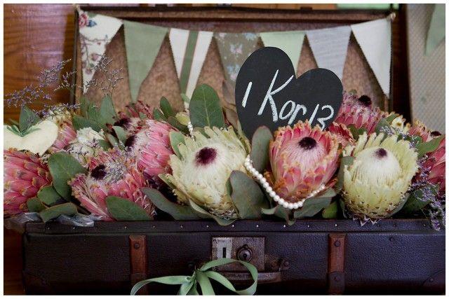 Google Image Result for http://www.southboundbride.com/wp-content/uploads/2012/06/CJ023-southbound-bride-real-wedding-kronenburg-bernard-bravenboer-suitcase-bunting-protea.jpg