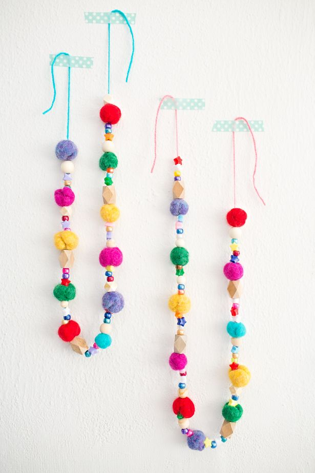 Kid-Made Felt Ball Garlands. Learn how to make felt balls with the kids and turn them into pretty beaded garlands!
