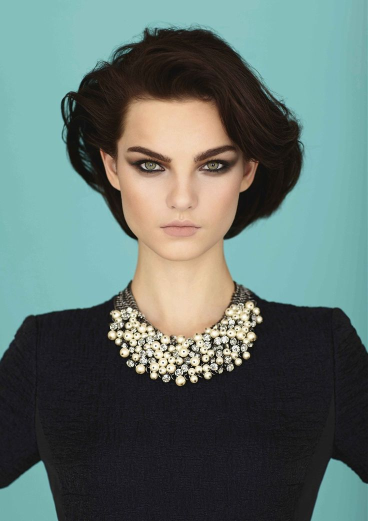 Large image of Short Black wavy hairstyles provided by Saks. Picture Number 23443