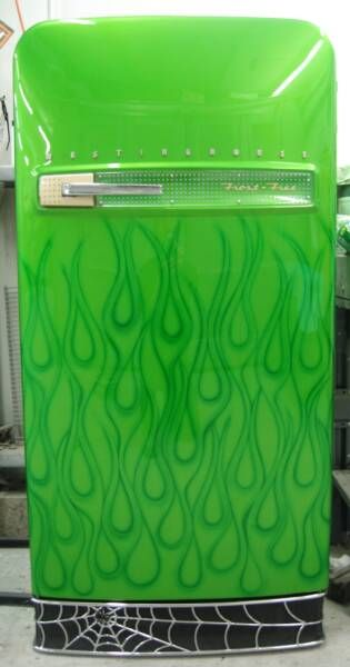 Custom painted vintage refrigerator. This one is a 1953 Westinghouse. The cabinet is refinished in candy apple lime green with organic green candy flames. Lower grill is handmade spider web, then chromed and spider added. Perfect for the hot rod garage.