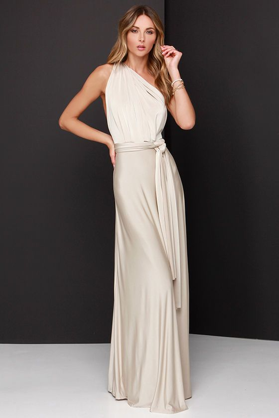 "Any which way you wrap it, the Always Stunning Convertible Beige Maxi Dress is one amazing dress! Two, 83"" long lengths of fabric sprout from an elastic waistband and wrap into dozens of possible bodice styles including halter, one-shoulder, cross-front, strapless, and more. Stretchy beige fabric has a satiny sheen, and a full length maxi skirt pairs perfectly with any choice you make up top. Want Styling Tips? <a href='http://bit.ly/HowToWearIt' target='_blank'>See How To Wear It!</a>"