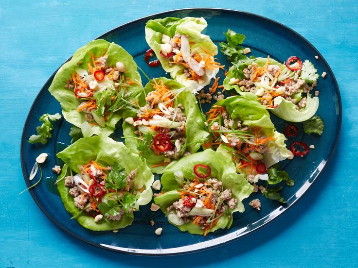 Recipe of the Day: Asian-Style Lettuce Wraps Instead of loading up your game-day spread with fried, cheesy and indulgent bites galore, feed your fellow fans these fresh, super-colorful lettuce wraps. Lay out the lettuce leaves, a zesty Asian-style ground meat filling and all the fixings so your guests can assemble each one to their liking.