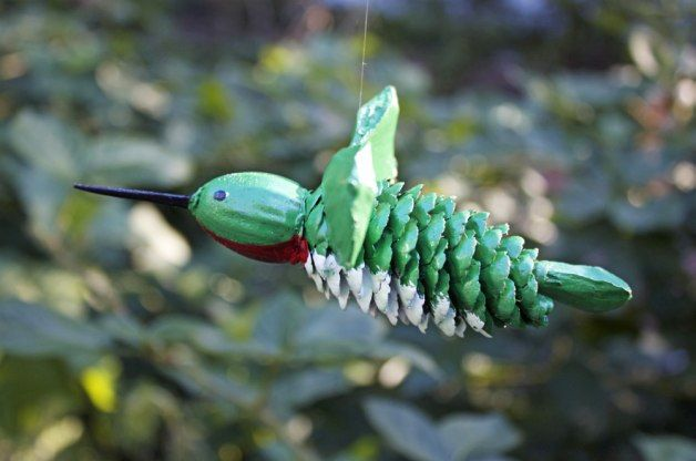Using objects found in nature, this pinecone hummingbird craft is a great fall project for adults or kids. Make several as ornaments for a holiday tree.