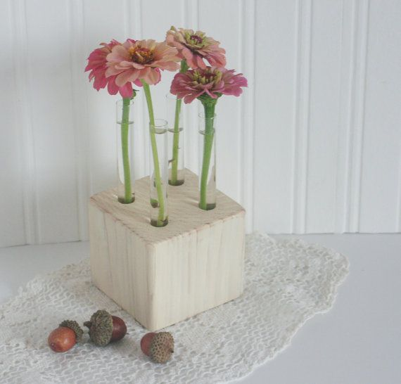 Flower vase with test tubes in wood block rustic painted