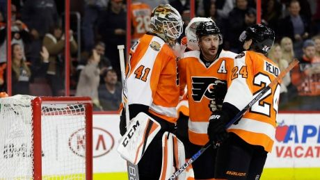 Flyers' Stolarz holds off Flames in NHL debut