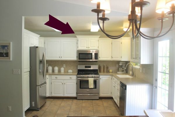 Lift the small cabinet above the microwave to add visual interest: Kitchens Remodel, Back Doors, Small Cabinets, Kitchens Ideas, Kitchens Layout, White Cabinets, Big Budget, Crowns Moldings, Kitchens Makeovers