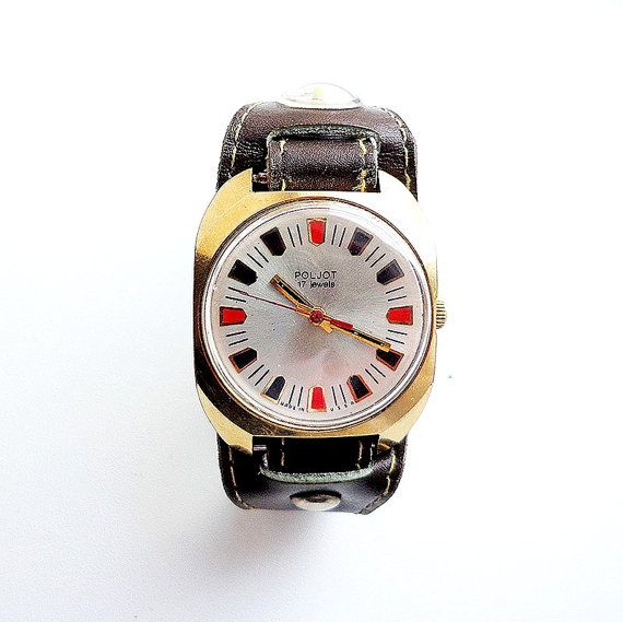 Poljot (means Flight) is a brand of Soviet and Russian watches which produced the First Moscow watch factory (Watch factory Poljot) since the 1960s . In 1964 watch the 1st Moscow watch factory began to be marked with the registered trademark Poljot.  Specification: - mechanical manual winding watch; - watch mechanism ; - gold-plated watch case AU10; - 17 jewels; - grey-silver color dial with black-red marks; - old strap with compass; - export brand.  Watch is in very good condiions. The…