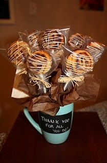Individually wrapped cinnamon rolls bouquet. My son would love this.  Cinnamon rolls are his favorite breakfast.
