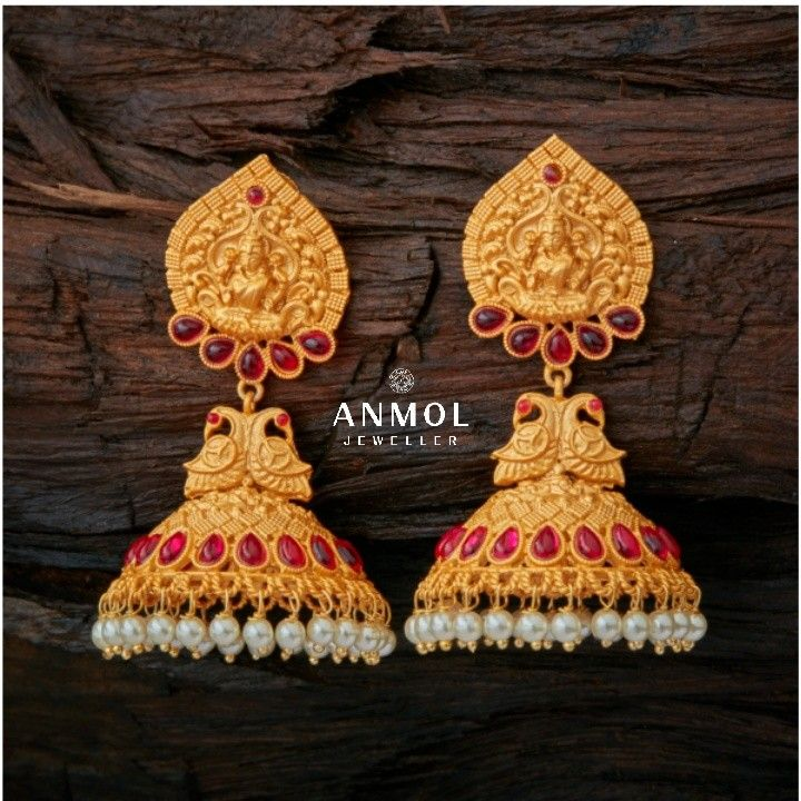 The traditional gold jhumki with beautiful artwork fused with ruby and pearls look so fabulous.. #anmol_jeweller  #gold #jhumki #earing #antique #artwork #jewel #jewellery #ruby #pearl #hanging #beautiful #gorgeous #lavish #traditional #ethnic #lavish #royal #lovely #luxury #designer #bold #ootd #jeweloftheday  For queries call or watsapp: 9910401704.  To place order mail us at:Anmol.jeweller01@gmail.com