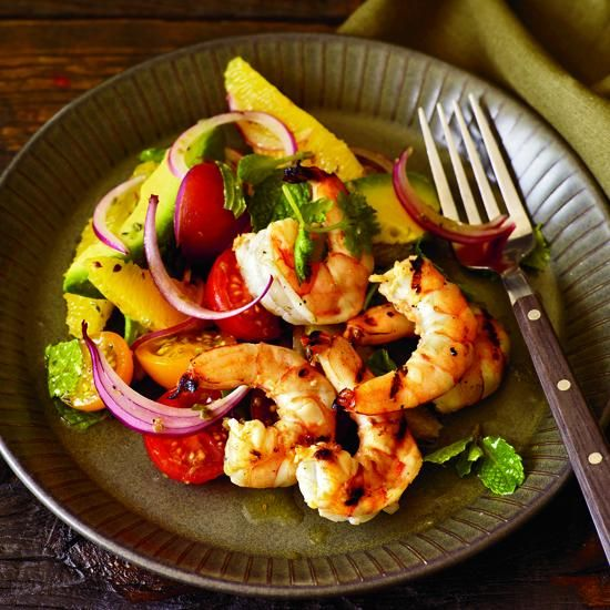 "Grilled Shrimp with Mom's Avocado-and-Orange Salad | Andrew Carmellini's dish is a mix of two beloved salads: shrimp-avocado and shrimp-citrus. He throws in a few surprises, too, like the hot sauce in the dressing. He recommends a fruity one from the Caribbean made with habaneros: ""Habaneros are crazy,"" he says."
