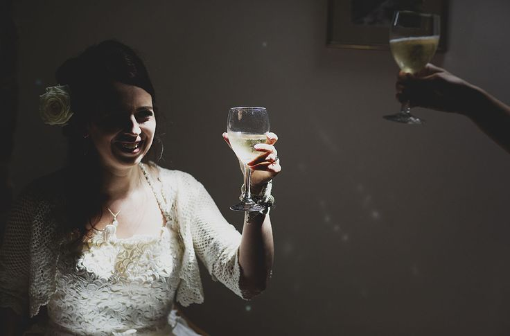 Creative wedding photography // Peak District wedding // Bride getting ready // That glass of bubbly before // By Inta Photography // http://intaphotography.com