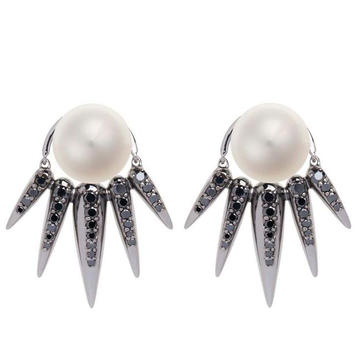 Nikos Koulis Spectrum collection stud earrings featuring black diamond spikes cradling a classic white pearl.