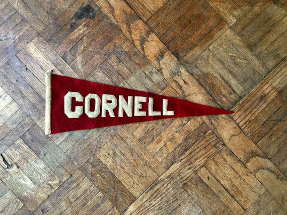 VINTAGE FELT PENNANT, 1920S CORNELL UNIVERSITY FELT PENNANT, BIG RED BEAR RED AND WHITE COLLEGE PENNANT FLAG  Early collegiate Cornell University pennant. Beautifully aged, displays great! Iconic Cornell University red and white. Thick felt, perfectly softened and worn. Felt letters are stitched on. Quality construction, tight machine stitch. Good vintage condition overall. Colors still bright and bold, deep carnelian red and white, white more of a beige from aging. A few small moth holes…