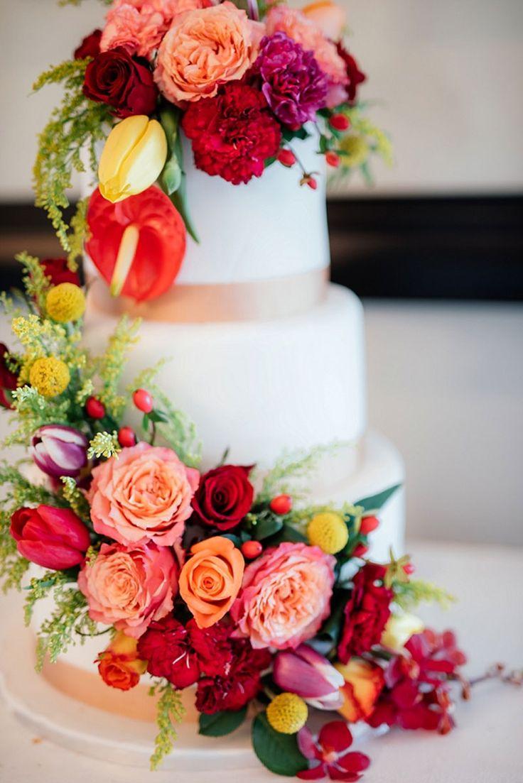 Bright flowers, bold colours, white wedding cake
