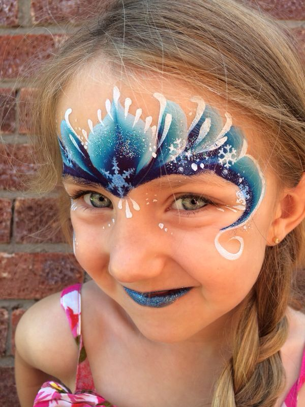 Frozen face paint  I really love the basic strokes of this, yet it looks impressive.  I think it'd look better with slightly lighter color values.  The navy or midnight blue is a bit too powerful for my preference.  Very pretty though!
