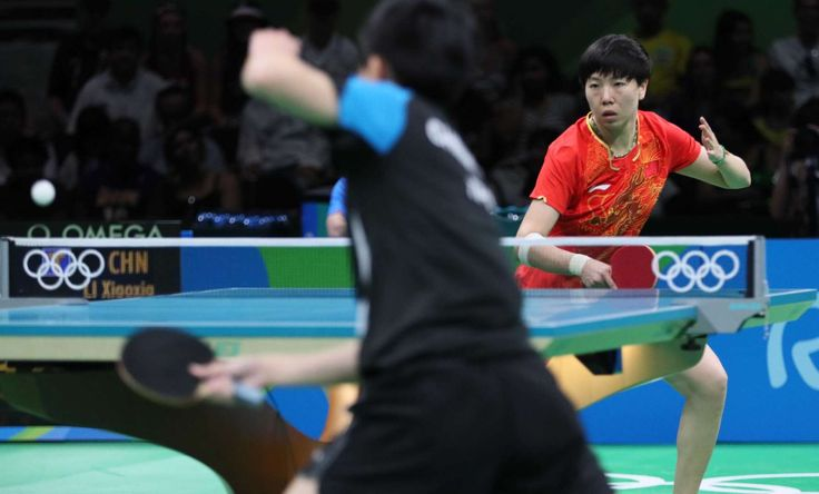 I-Ching Cheng of Chinese Taipei faces off against Xiaoxia Li of China during women's singles table tennis quarterfinals in the Rio 2016 Summer Olympic Games at Riocentro - Pavilion 3.
