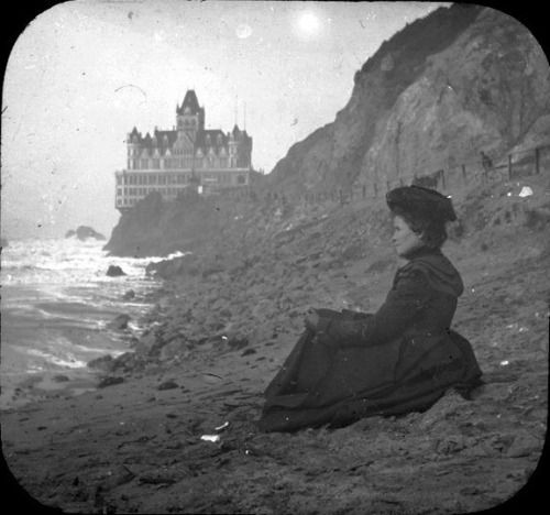 Woman sitting at the beach near the Cliff House in San Francisco, c.1900 #sanfrancisco #CliffHouse #Victorian