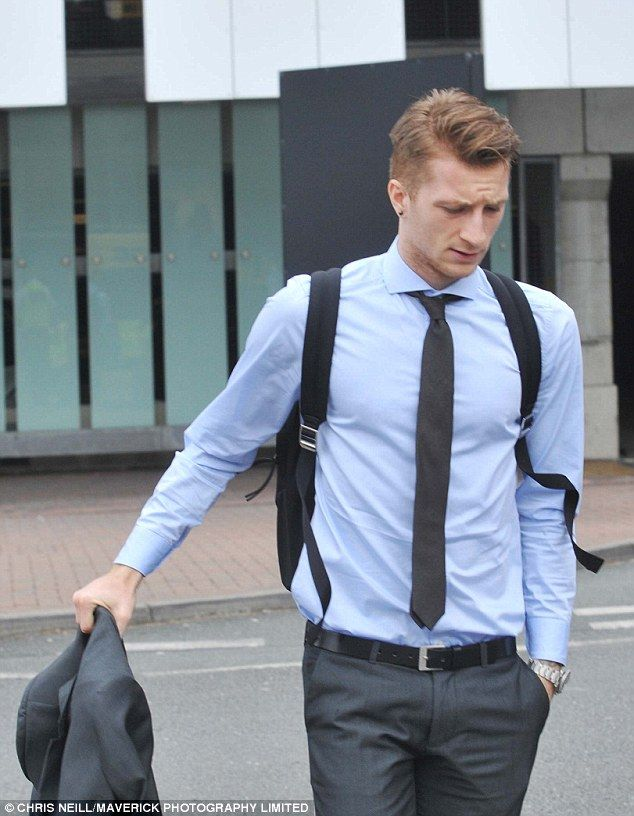 Marco Reus looks gutted as he prepares to fly home following Tuesday night's dramatic events