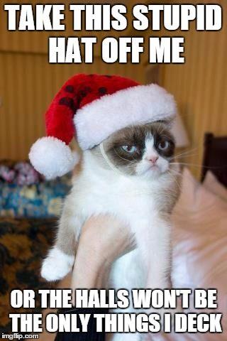 Fa la la la la, la la la......jingle bells | TAKE THIS STUPID HAT OFF ME OR THE HALLS WON'T BE THE ONLY THINGS I DECK | image tagged in memes,grumpy cat christmas,grumpy cat | made w/ Imgflip meme maker