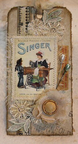 Handmade vintage sewing-themed tag, embellished with fabric, lace, buttons, pins, ephemera
