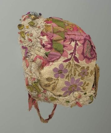 1850 Peasant bonnet, brocade on white ground white net ruching around face and neck. Museum of Fine Arts, Boston
