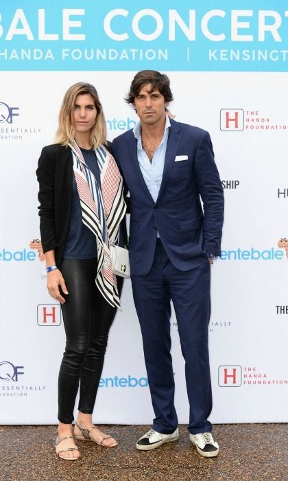 Polo pro and pal of the royal Nacho Figueras posed with his wife Delfina Blaquier for photographers as they arrived to Kensington Palace.