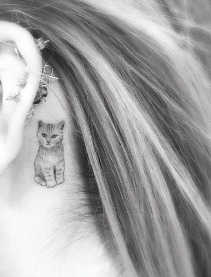 Small Cat Tattoo Behind The Ear by Doctor Woo