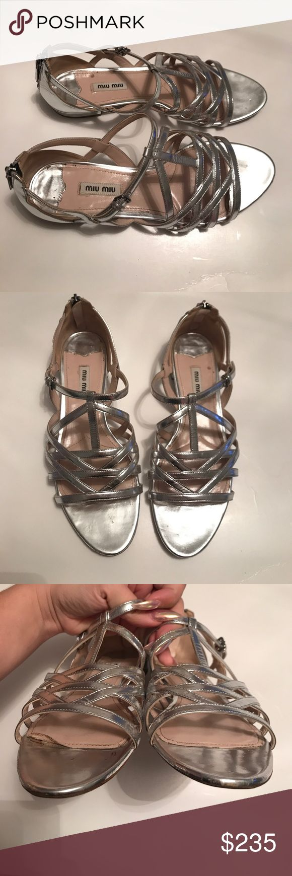 MIU MIU Prada silver strappy sandal Sz 39.5 Fashionable, in great ore owned condition MIU MIU Prada silver strappy flat sandal. They are a size 39.5. Some creasing in back, and scuff to back heel portion. Black marker mark on bottom of one shoe. Top of the lining in one shoe on the footbed is rolled up coming up- please see photo. Still current and such a classic miu miu look! Miu Miu Shoes Sandals