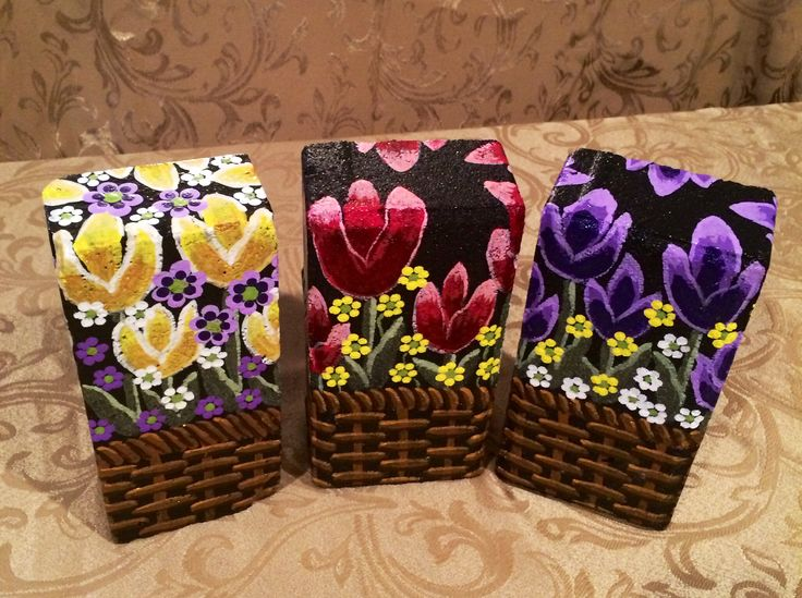 Flower baskets painted on bricks by Linda Hallett.