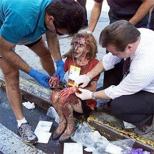 Simply Horrifying!! A Survivor of The World Trade Center Attacks Is Being Taken Care Of By Fellow Survivors!!            9/11 ~ Never Forget!!