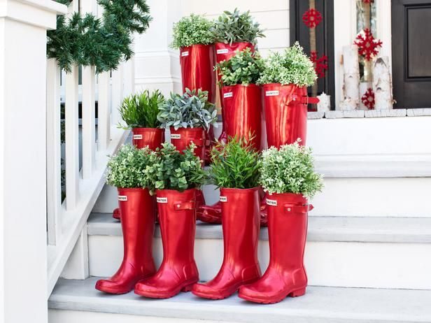 Add a touch of whimsy to your front steps with a grouping of boots used as vessels for greenery.