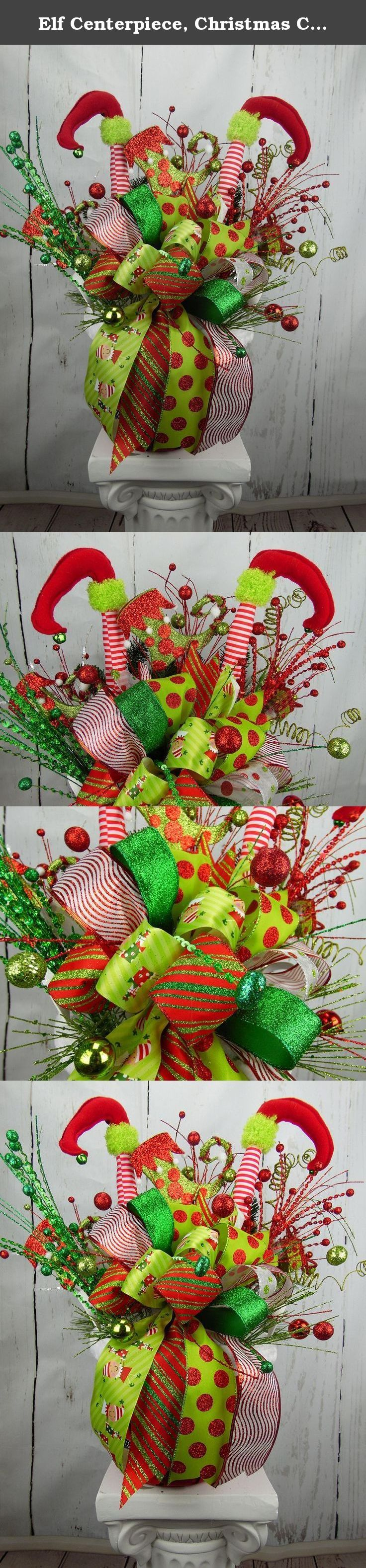 """Elf Centerpiece, Christmas Centerpiece, Holiday Centerpiece, Elf Leg Decor, Holiday Decor, Table Decor, Elf Decor, Red and Green Christmas. Celebrate the upcoming Holiday season with this cute centerpiece that features the traditional colors of Christmas. This cute red basket features a glittery """"belt"""" just like Santa!! The basket is filled with a large bow made up of 6 different wired holiday ribbons. The focal point of this centerpiece is the cute elf legs and shoes with the bells on…"""