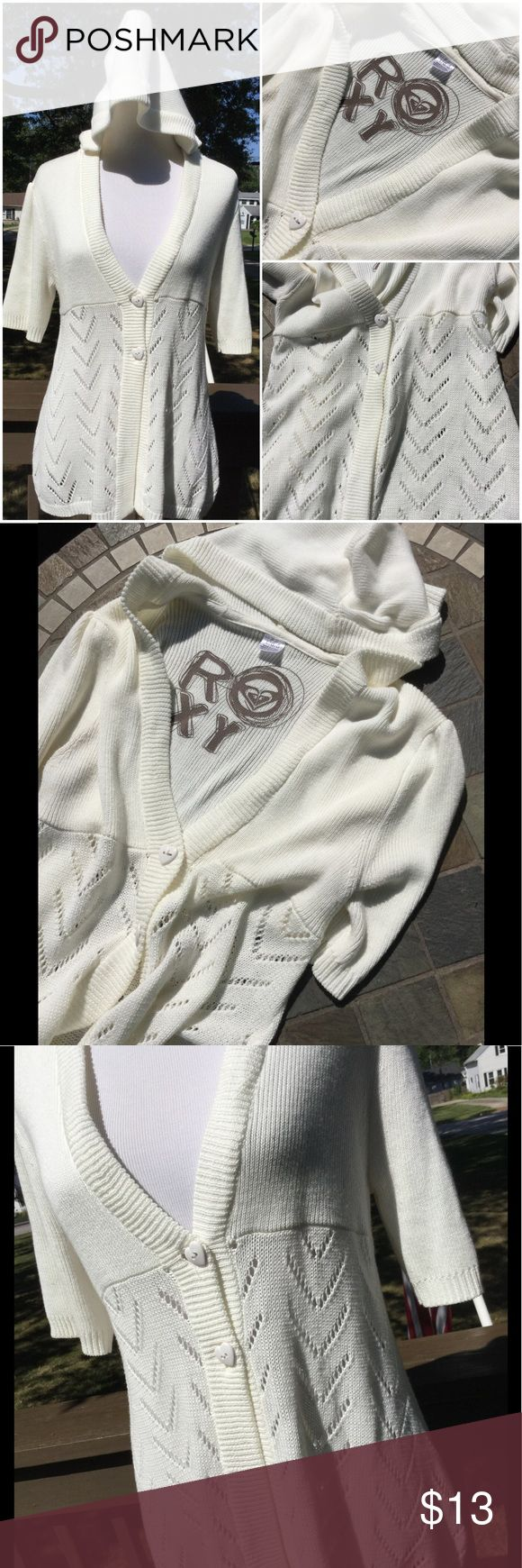 """🆕 Roxy Cardigan Sweater with Hood ! 🌸  Roxy ! Light cream colored cardigan sweater with a hood ! V neckline to 2 heart shaped buttons ! About 27"""" length ! Cotton & acrylic ! Bottom half has open knit chevron design ! Short sleeves ! So cute ! 🌸 Roxy Sweaters Cardigans"""