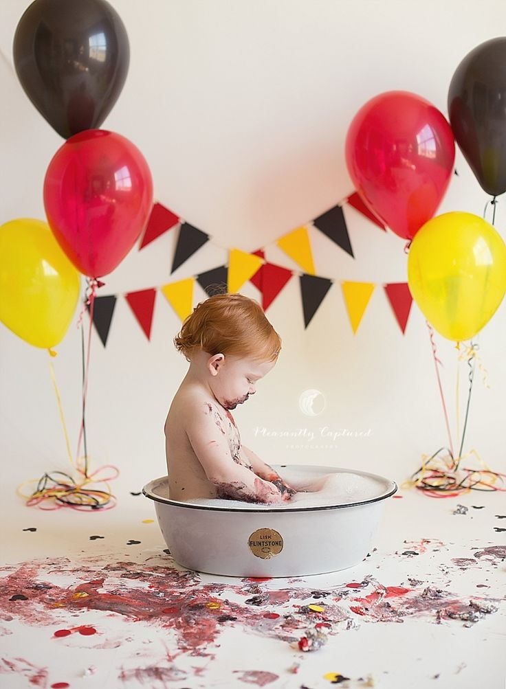 Little boy gets clean in small bath after having a Mickey Mouse themed cake smash   Pleasantly Captured Photography   Cake Smash   Baby Photographer   Professional Photographer Jacksonville NC