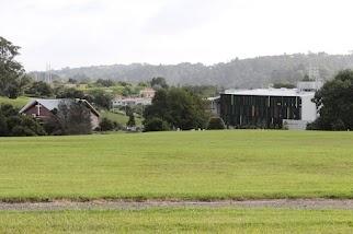 Albany Senior High School across the fields, and a church (Education, Social service)