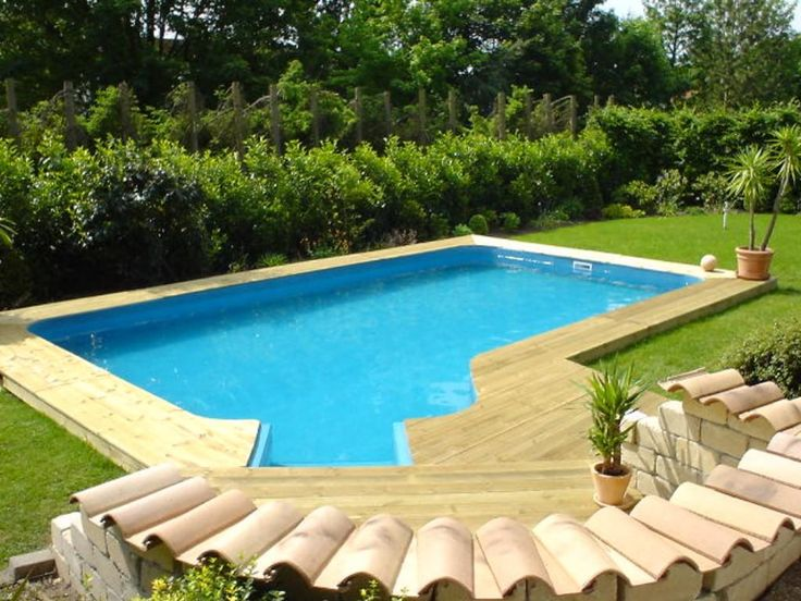home swimming pools on ground - Above Ground Fiberglass Lap Pools