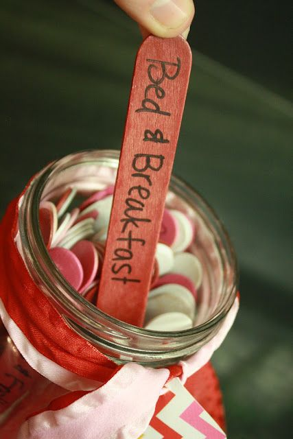 Date night jar with color coded popsicle sticks. Red: $$$ + planning beforehand. Pink: $ + spontaneous. White: Stay at home. (Click through for ideas!)