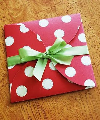 Hand-made gift boxes out of Cardstock or even old christmas cards