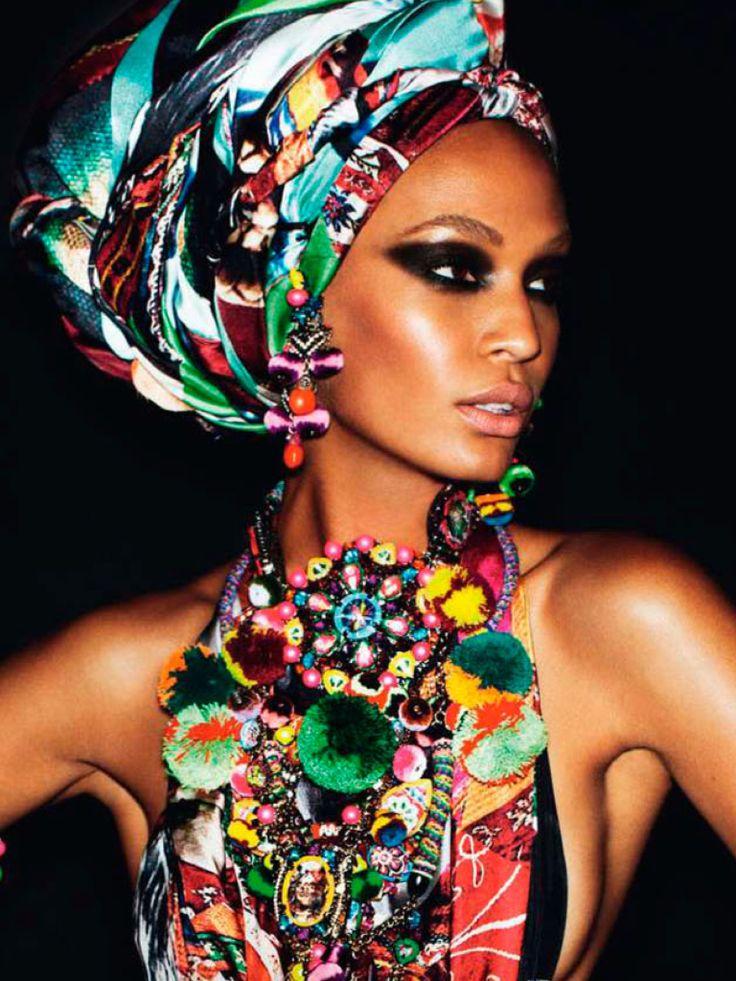 gorgeous tribal print turban, dramatic black eye shadow and bright graphic halter